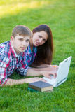 Young teen couple with laptop computer Royalty Free Stock Image