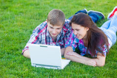 Young teen couple with laptop computer Stock Photography