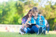 Young teen couple with notebook Stock Photos