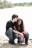 Young teen couple outdoors by river jeans Stock Photography
