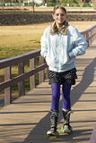 Young Teen Crossing Bridge on Stroller Skates Stock Photos