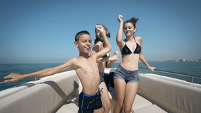 Young teen dancing on a yacht stock video