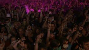 Young teen fan cheering dance in open air concert stock footage
