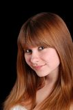Young teen female on black stock photo