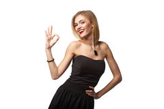 Young teen female showing gesturing OK against white background Stock Image