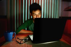 Young Teen in front of a laptop computer Stock Photo