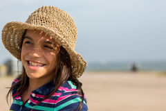 Young teen girl at beach with hat Royalty Free Stock Photos