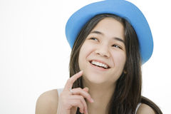 Young teen girl in blue hat, thinking Stock Photos