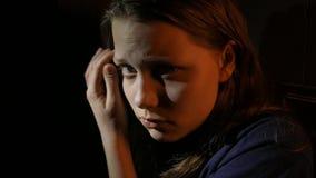 Young teen girl in the dark, UHD 4K. Young teen girl in the dark, closeup, UHD 4K native video stock video footage