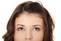 Young teen girl with her eyes looking up Royalty Free Stock Photos