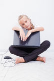 Young teen girl with laptop Stock Images