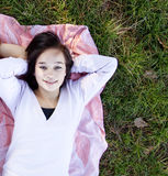 Young teen girl lie at grass. Stock Photos
