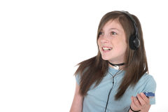 Young Teen Girl Listening To Music 5. Cute, smiling, young teenage girl standing and listening to music with headphones and mp3 player; shot on white stock photography