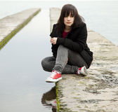 Young teen girl at outdoor near water Royalty Free Stock Image