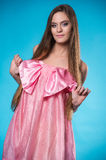 Young teen girl in a pink dress posing Royalty Free Stock Photography