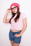 Young teen girl in pink hat and glasses Stock Image