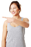 Young teen girl pointing on something. Royalty Free Stock Image