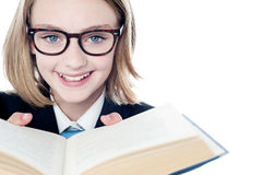 Young teen girl reading a book Stock Photos
