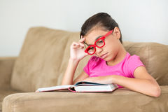 Young teen girl reading bored Royalty Free Stock Photo