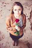 Young teen girl with red rose Stock Photos
