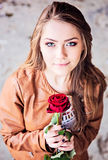 Young teen girl with red rose Royalty Free Stock Image
