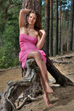 Young teen girl is resting in a forest, in countryside. Royalty Free Stock Photo