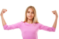 Young teen girl showing her muscular arm for feminine and independent strenth,isolated Stock Images