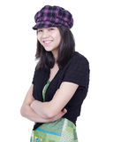Young teen girl smiling, arms crossed, wearing hat Stock Photos
