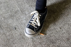 Young Teen Girl Smoking a Cigarette. Girl smoking a cigarette in a parking garage Stock Images
