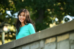 Young teen girl standing on bridge Royalty Free Stock Photography