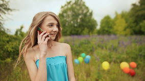 Young teen girl talking on the phone stock video
