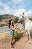 Young teen girl with white horse royalty free stock photos