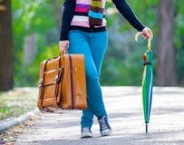 Young teen girt with suitcase and umbrella Royalty Free Stock Photo
