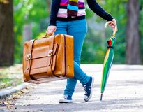Young teen girt with suitcase and umbrella Stock Photo