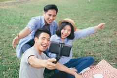 Young teen groups selfie by mobile phone. royalty free stock images
