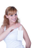 Young teen hanging piece of paper from the clothes royalty free stock photography