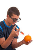 Young teen happy to do experiments with fruits Royalty Free Stock Photos