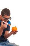 Young teen happy to do experiments with fruits for chemistry lab Royalty Free Stock Image