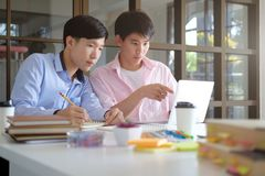 Young teen helps friend catching up and learning. stock photos
