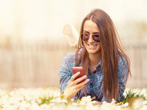 Young teen hipster outdoor using cellphone Stock Images