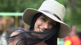 Pretty teen girl winking stock footage