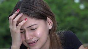Tearful Pretty Female Teen Girl Crying. A young teen hispanic girl stock footage
