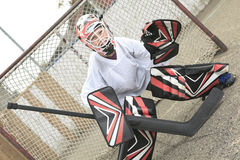 Young teen hockey goaler outside in the arena Stock Photography