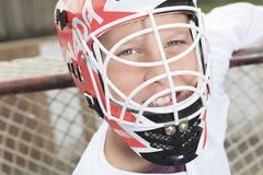 Young teen hockey goaler outside in the arena stock image