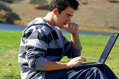Young teen laptop man Royalty Free Stock Image