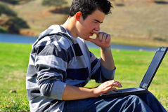Young teen laptop man. Royalty Free Stock Images