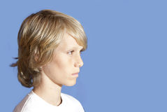 Young teen looking wary stock photo