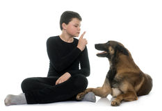 Young teen and malinois. In front of white background Royalty Free Stock Images