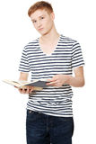 Young teen man is reading a book Stock Image