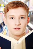 Young teen man is reading a book. Royalty Free Stock Image